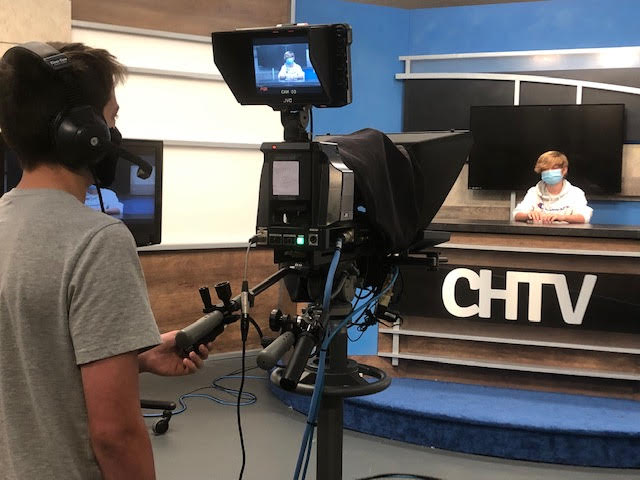 CHTV+staff+members+prepare+for+recording.+CHTV+gear+is+consistently+sanitized+with+breaks+every+fifteen+minutes+to+assure+safety+and+health.