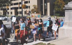Student activists walk the home stretch of the Global Climate Strike at the Indiana Statehouse in September 2020. Maanya Rajesh, Green Action club president and junior, said the activists, many of whom were CHS students, marched in support of climate policy reform and greater awareness of the global issue.