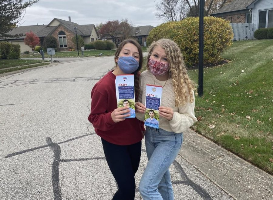 Juniors Lisa Venckus (left) and Erin Gordon (right) pose for photo while holding 'Fady for Indiana' brochures. Venckus said that