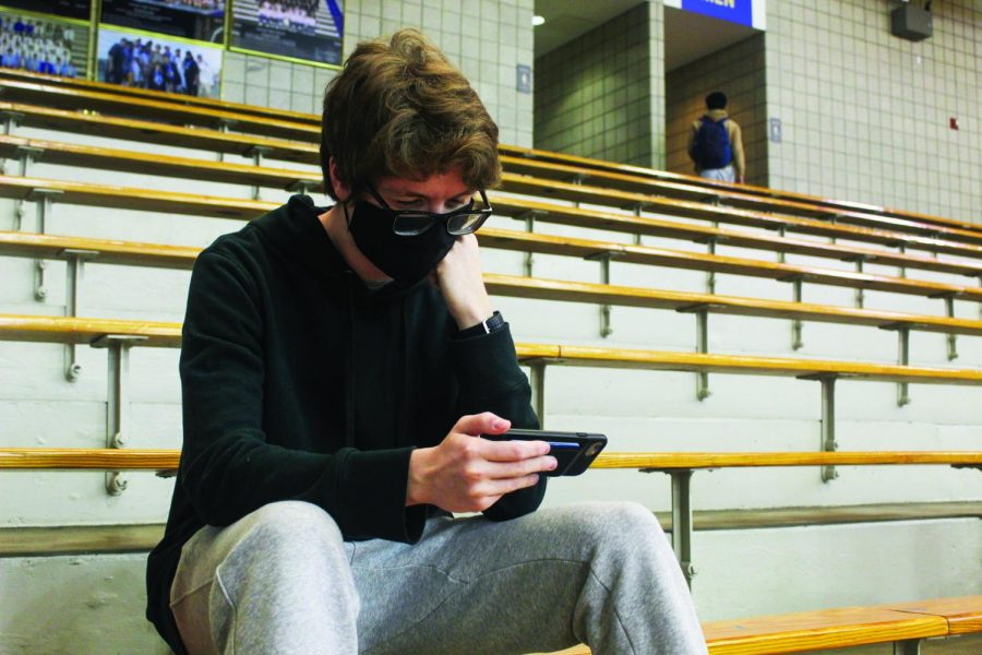 Junior Nolan Jones streams sports games on his phone. According to Jones, he prefers streaming sports games because he does not have cable TV.