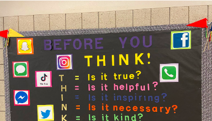 The media center demonstrates the 'THINK' method of online posting on a bulletin board outside of the Greyhound Media Network to raise awareness for Teen Tech Week. Ramos said safe posting and anti-plagiarism efforts are the goals for the media center during this time.