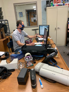 WHJE radio adviser Dominic James looks at his desktop in his office. James said WHJE updated their website and fixed the listen live button. He added that he encourages people to take a look at the new podcasts added to the website as well.