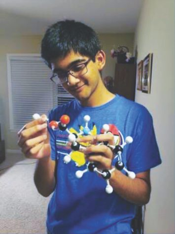 Junior Labeeb Hossain analyzes his protein model of the amino acid phenylalanine at his home.Hossain said he is aware there are some conflicts between religious and scientific doctrines, but said he is open to modifying his beliefs to accept scientific facts.