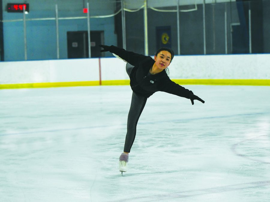 LONG GLIDER: Junior Claire Qu glides on one leg during her practice at the ice rink. She said one of the hardest parts of ice skating is being consistent and being able to balance every part of her body the correct way so she does not fall down.
