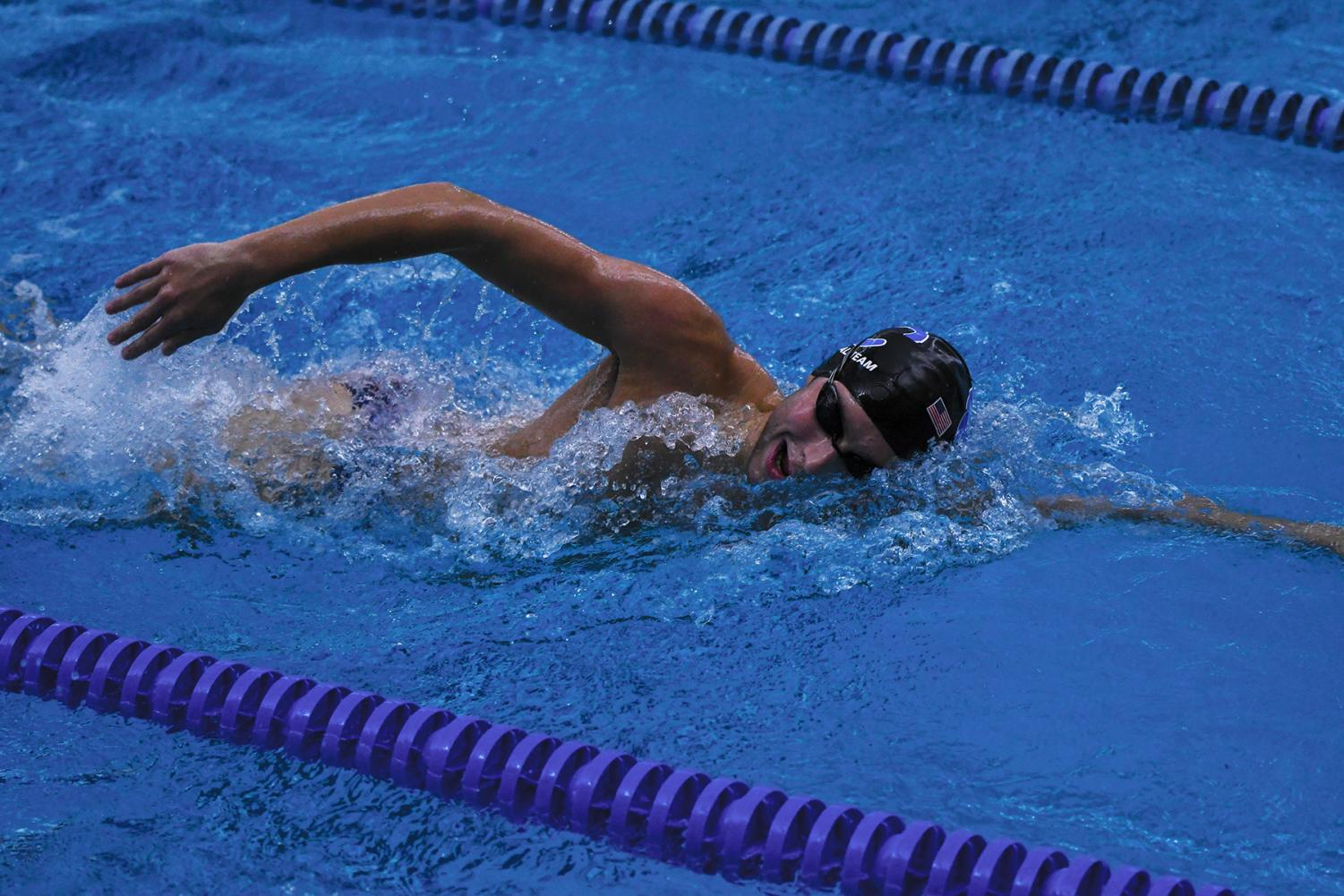 Griffin Hadley, varsity swimmer and senior, takes a breath during a practice swim. According to Hadley, his winter workouts are often more rigorous than his school ones.