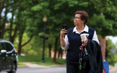 A woman holds her phone, taking a photo of a protest on June 1. The protest was led by sophomore Klay Gabriel, she said it was the first event she ever organized.