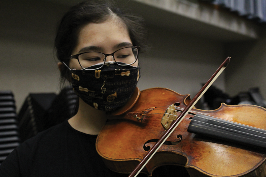 Natsume Wu, IU string academy violinist and junior, plays her violin after class because, she said, she has more time to practice.