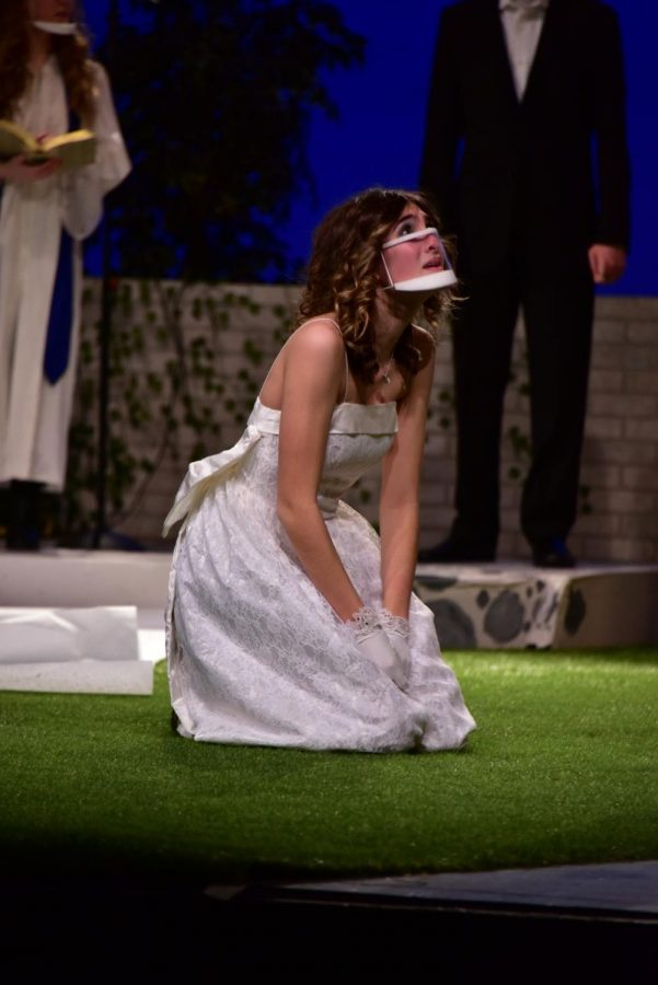 """Kate White, actress for Hero and senior, kneels on the ground during a scene in the theater production """"Much Ado About Nothing."""" The cast performed live from Feb. 4 to 6, and the show aired virtually from Feb. 12 to 14 on the Carmel Drama website."""