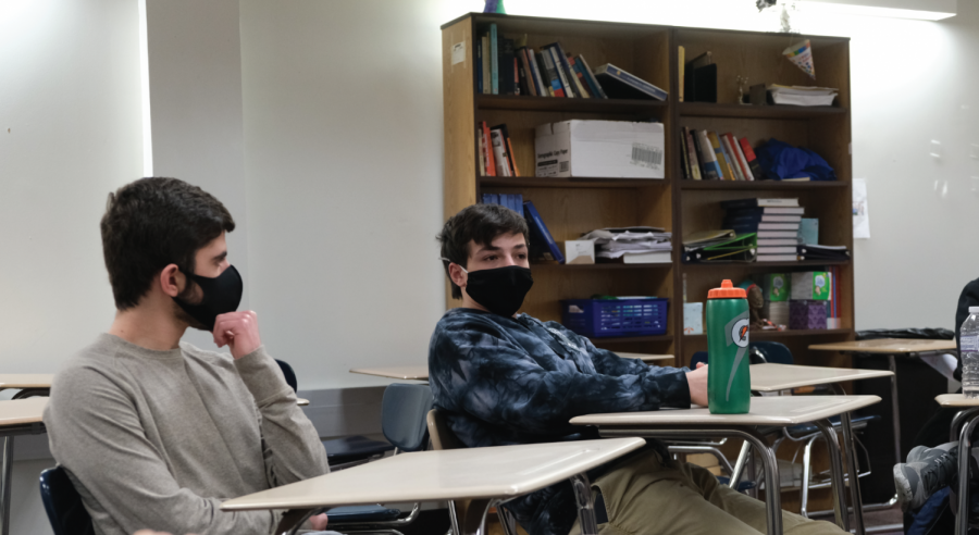 Seniors Jordan Paraboschi (left) and Daniel Schrader-Dobros (right) discuss the existence of conscious thought during a Crossfire meeting on Jan. 21. To find out more information about Crossfire club, look on its instagram @crossfire_chs.