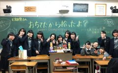 12th-grader Aika Uda (fourth from left) poses with classmates and handmade candy on Valentines Day. Uda said it's customary in Japan for women to give chocolates all the men in their lives.