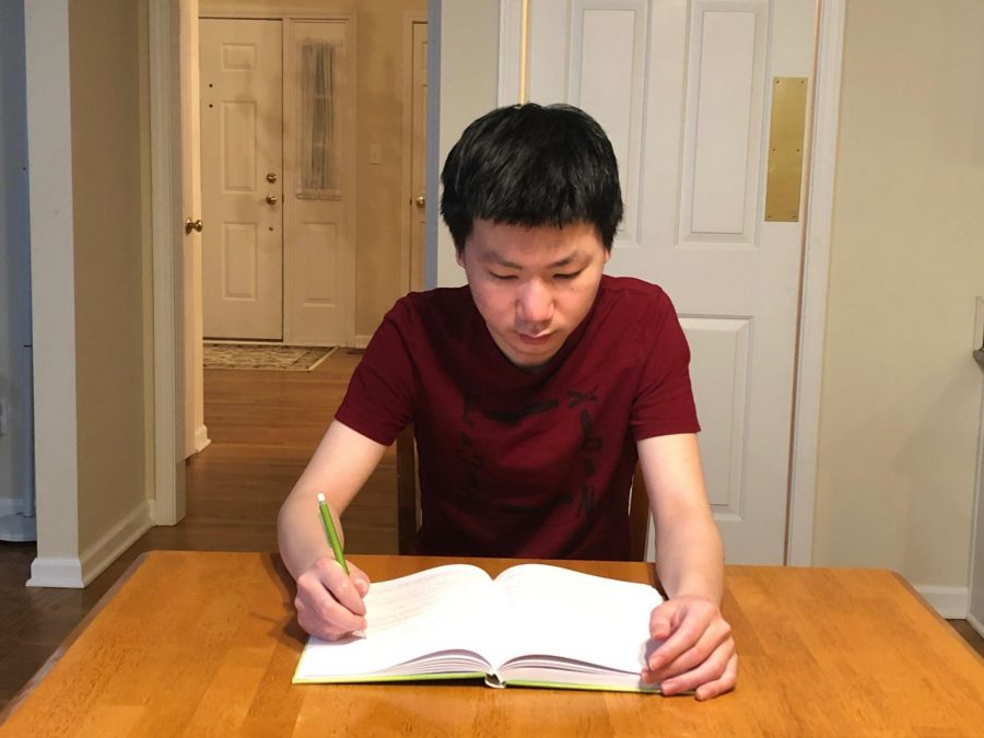 Jack Liu, co-president of the Math Club and junior, sits at his desk practicing problems for the American Mathematics Competition. Liu said that at the next meeting the club members will be practicing problems geared for the second competition, or at least types of problems that have frequently appeared in the competition over time.