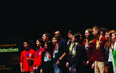 Senior Lalith Roopesh (6th from left) recieves a medal for one of his events at the University of Michigan Science Olympiad Invitational during his junior year. Roopesh said college tuitions were an important part of his considerations when he applied to colleges in late 2020, and Science Olympiad offers some scholarships to seniors