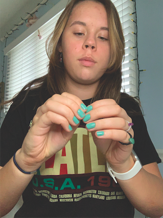Using an assortment of wires, string and beads, sophomore Izzy Monger creates products for her store. She learned how to work with the materials last year and her business took off a couple of months later.