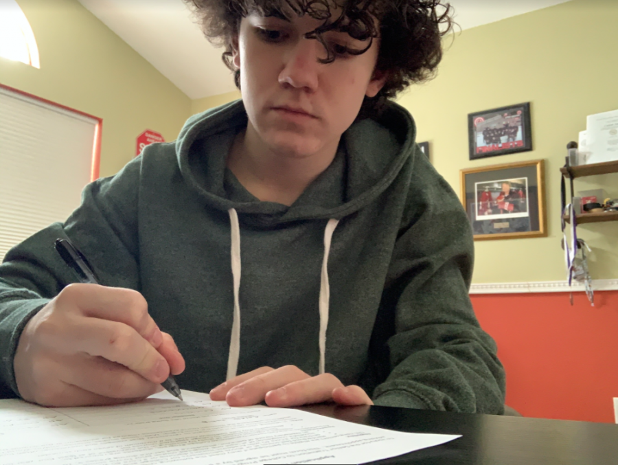 Junior Caleb Suhy fills out the Transition to College Program application form. Suhy plans on taking five classes both semesters per his counselor's advice.