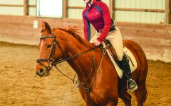 ROUTINE RIDE: Clare Leedke, horseback rider and sophomore, controls her horse on a practice ride. According to Leedke, controlling a galloping horse while riding is much harder than a traditional trail ride.