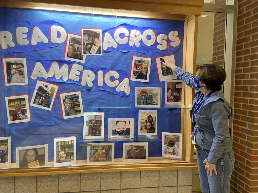 Media center specialist Gail Marcopulos works to put up a display for Read Across America. This event is open to teachers and they can participate by sending in a 'shelfie' with their favorite book, as seen above, or by choosing a different way to participate.