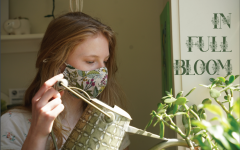 Sophomore Josie Paxton waters the plants in her windows. She said having plants is beneficial to her mental health.