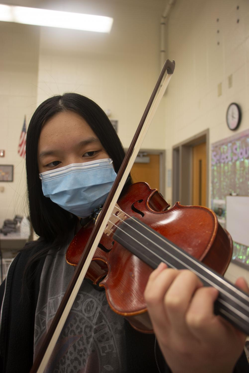 Freshman Carolyn Jia plays her instrument in preparation for ISSMA. She practices independently, in private lessons and in Concert Orchestra so she can perform well in ISSMA, even though it is virtual this year.