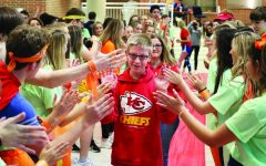 Navigation to Story: Assistant athletic director, students acknowledge sports as force for good