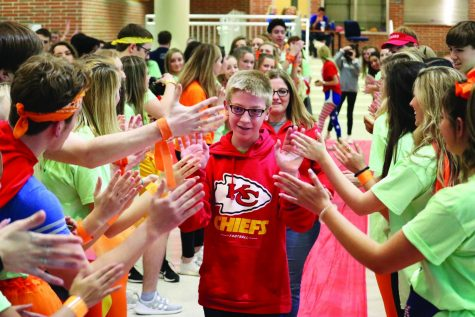 Assistant athletic director, students acknowledge sports as force for good
