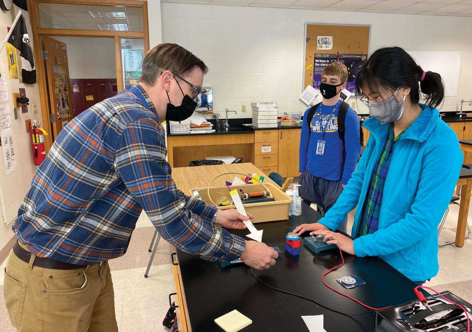 Briana Chen, AP Physics C student and senior, performs a demonstration that demonstrates the existence of magnetic fields.