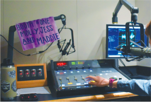 Evan Sanders, WHJE podcast creator and junior, adjusts controls inside a CHS radio booth. Sanders said that podcasting does not require much engagement or focus and can be done virtually anywhere to the listener's benefit.