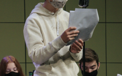 "Theatre student and sophomore Theodore Curtis practices his lines and his part in preparation for the ""Radio Mystery Theatre."" The cast held their show on Nov. 12 through Nov. 14. The radio show focused on a murder mystery and how the case was solved."