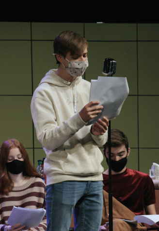 """Theatre student and sophomore Theodore Curtis practices his lines and his part in preparation for the """"Radio Mystery Theatre."""" The cast held their show on Nov. 12 through Nov. 14. The radio show focused on a murder mystery and how the case was solved."""
