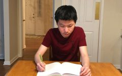Jack Liu, co-president of the Math Club and junior, sits at his desk practicing problems for the United States of America Mathematical Olympiad (USAMO) competition. Liu said that at the next club meeting, Tuesday after school in Room H207, the Math Club members will be reviewing the results from the USAMO and the United States of America Junior Mathematical Olympiad (USAJMO) competition from earlier this month.