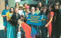 "Jim Peterson (farthest back), co-director of theater and film who has worked at CHS since 1992, poses with the Rising Star club before the Homecoming parade in 2007. ""(The Homecoming parade) was a really special time,"" he said."