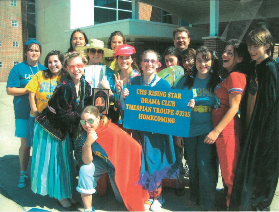 """Jim Peterson (farthest back), co-director of theater and film who has worked at CHS since 1992, poses with the Rising Star club before the Homecoming parade in 2007. """"(The Homecoming parade) was a really special time,"""" he said."""