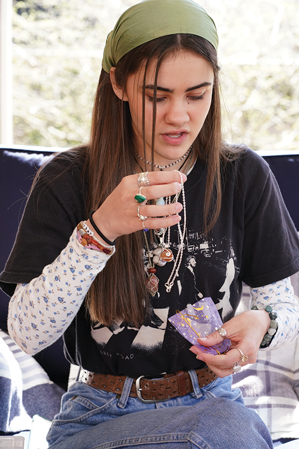 Senior Mary Grace Jacko bags a necklace she made for one of her customers. Jacko's business is a jewelry and crystal business. Before she packages her customers' orders, she cleanses the merchandise with sage to ensure that the energies in the crystal were not affected by her as she made the products. After doing this, she secures the jewelry in a bag of her choice, ready to be put into a package.