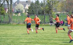TERRIFIC TEAM: Junior Joey Duncan (second from left) fist bumps one of his teammates during his soccer game. Duncan said everyone is included when playing recreational soccer.