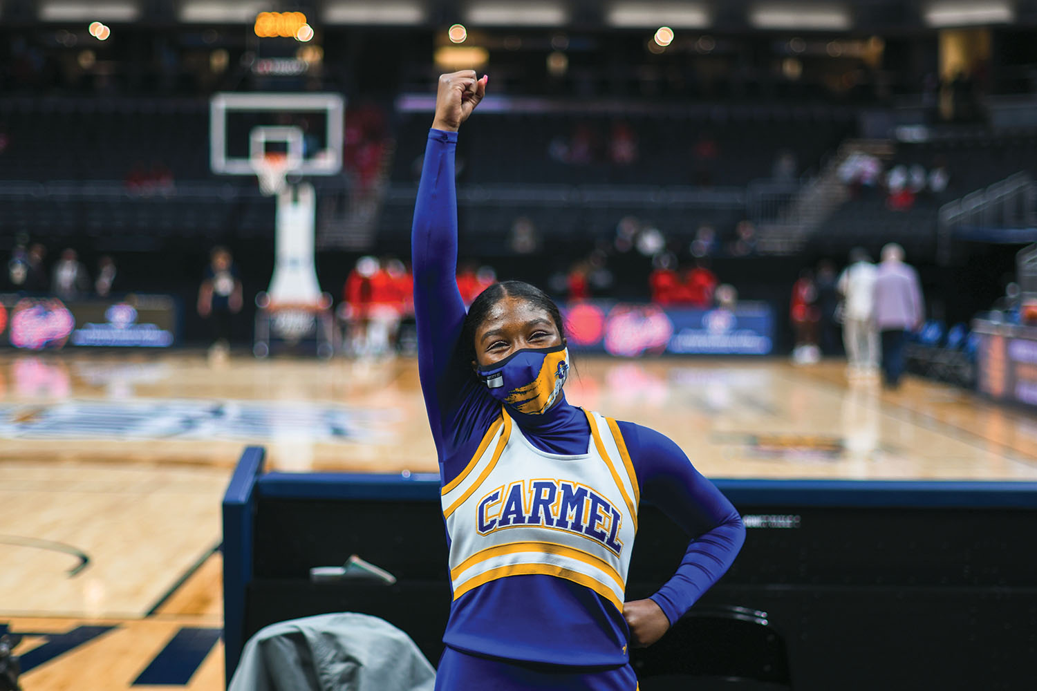 Trinity Griffin, varsity cheerleader and senior, cheers for the varsity basketball team at a home game in March. She said one of the biggest challenges to being a student athlete is trying to maintain grades at school while performing for a sport. Although she said she values her grades, she said she prioritizes her mental health over her school work and grades.