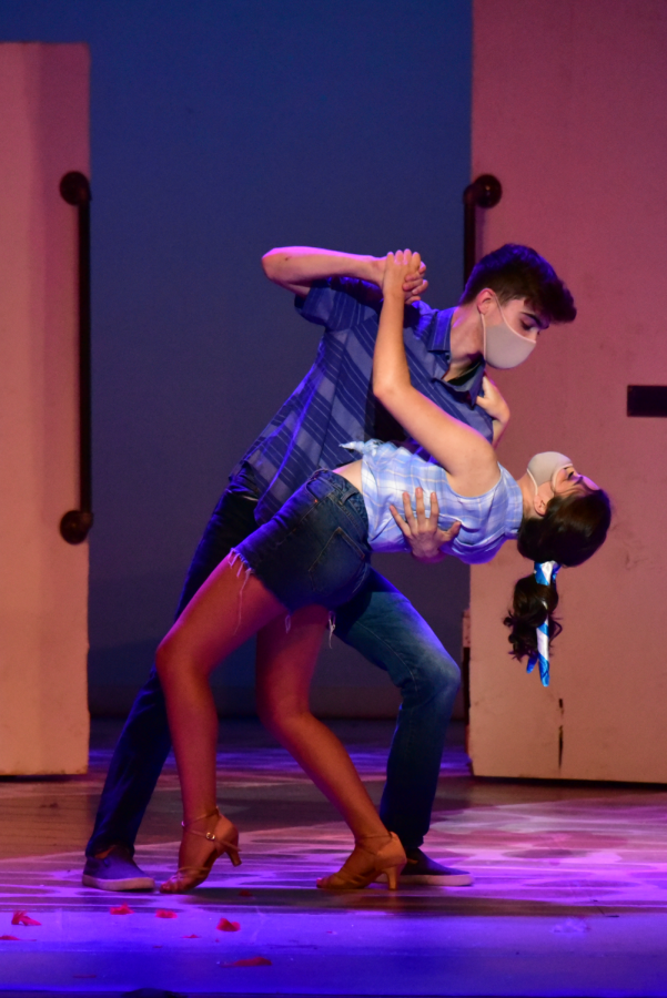 Junior Michael Geary (left) dances with senior Ellie Sanchez (right) during a dress rehearsal for Mamma Mia. Geary and Sanchez played the two love interests, Sky and Sophie, in the show. The cast performed the musical live on May 6 to 8 in the Dale E. Graham Auditorium.