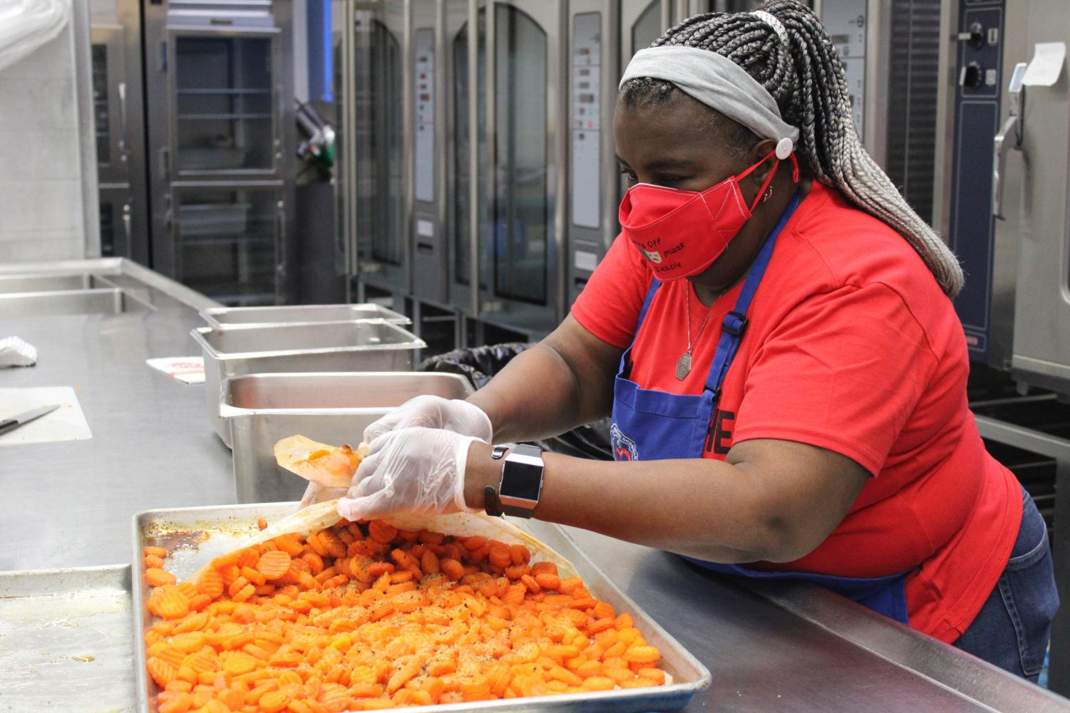 Cafeteria Worker Debbie Brown prepares a vegetable a la carte food choice. The CCS district will continue with the free meal plan for all students for the 2021-22 school year.