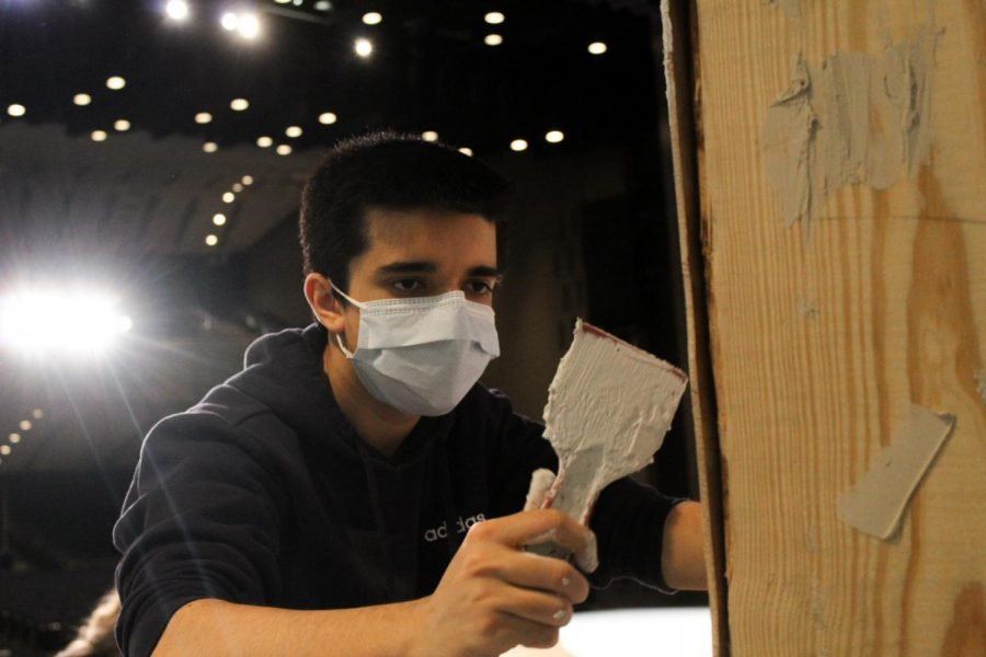 Nyle Nasir, tech crew member and junior, works on a set for the CHS production of Mama Mia. The preforming arts department hosted the musical from May 6 to 8 in the Dale E. Graham Auditorium.