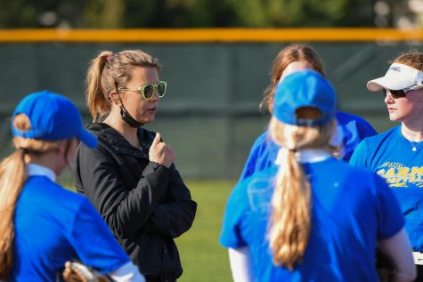 Members, head coach, of women's softball team acknowledge benefits of female coaches, challenges for women in coaching