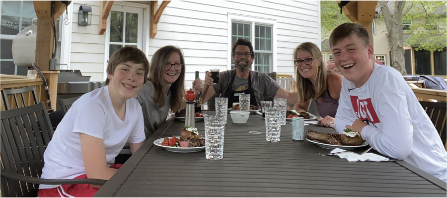 Freshman Braeden White (left) along with his brother, freshman Brooks White (right) and his mother, Amy White-Meadows  (middle-right) went to their grandparent's house for a family dinner  on May 2.