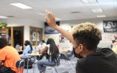 Zyrah Arulogun, member of Black Student Alliance (BSA), raises her hand to ask the police officers a question at a BSA meeting on May 13. Arulogun said that while the diversity training sessions are a step in the right direction, there is still more to be done.