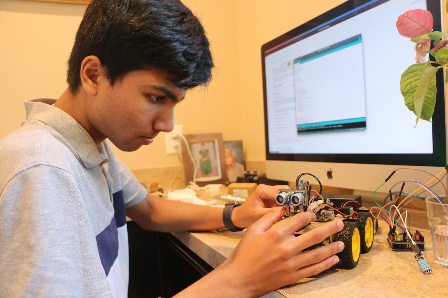 Senior Kashyap Akkinapally works on an engineering project. Akkinapally said he enjoys innovating to help his community.