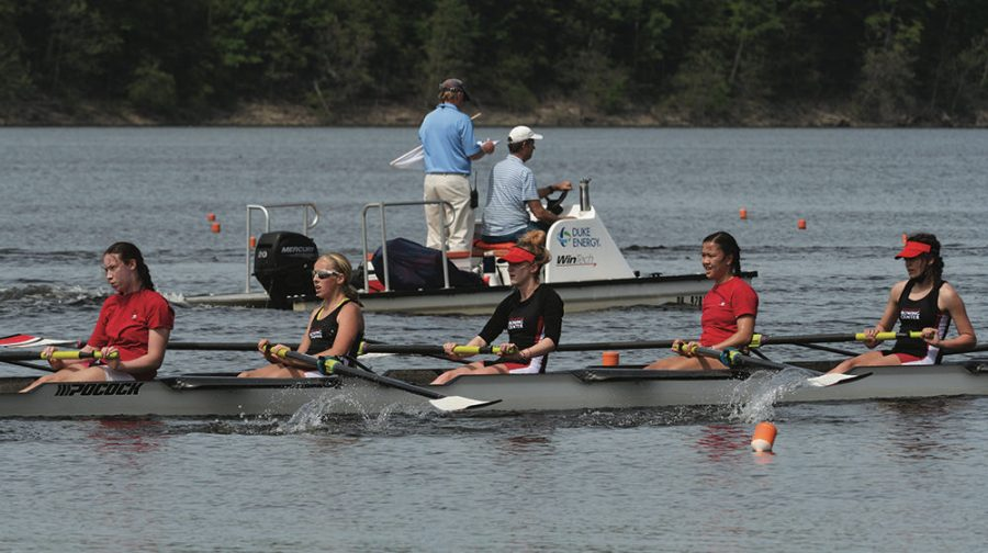 Junior Nyah Lam (second from right) watches the movements of her teammates. Lam said it is important for all rowers to be coordinated when rowing.