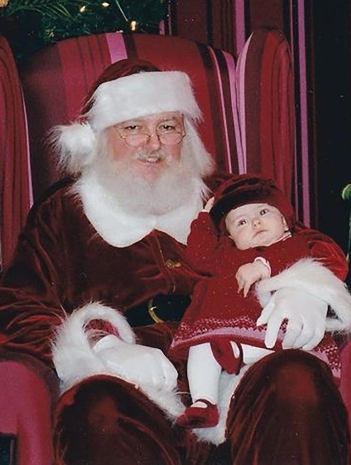 Senior Lillian Williams poses next to Santa Claus as a baby. She said even though her parents told her about Santa Claus, she never saw it as a lie. Williams said she will tell her own children about Santa Claus because she said she thinks it will be fun and will continue the tradition of good memories and gift-giving.