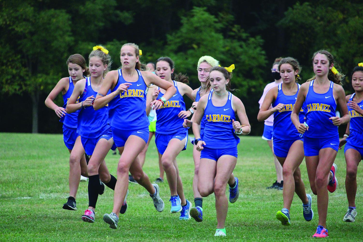 Members of the women's cross-country team run in a race last fall. Taylor Marshall will serve as the team's new coach for the upcoming 2021-22 season.