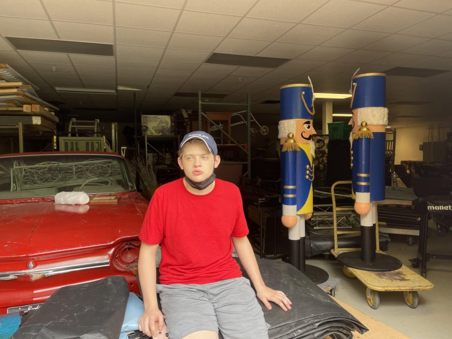 CHS Sophomore Brayden Perkins rests in front of one of the set pieces created by Tech Theatre. This set piece was brought in and refurbished as a prop many years back for use in automobile scenes.