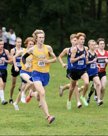 Kole Mathison, cross country runner and junior, breaks the five kilometer school record in a time of 14:52.10 at the Riverview Health Flashrock Invitational. Coach Altevogt said that the team will be top contender for the State championship in late October.