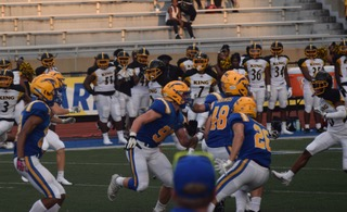 Varsity Football Competes Against Rival Center Grove High School on Sept.  3