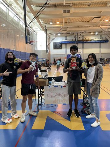 Caption: Ellis Nou, student body president and senior, poses with fellow Senate members at the fall blood drive. He said now they need to focus their energy on Homecoming day planning since it is coming up soon.