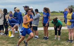 James Jay, cross country runner and junior, runs in the Zionsville preseason meet. Coach Altevogt said that the team is in a really good position to be a top team in the state this year.