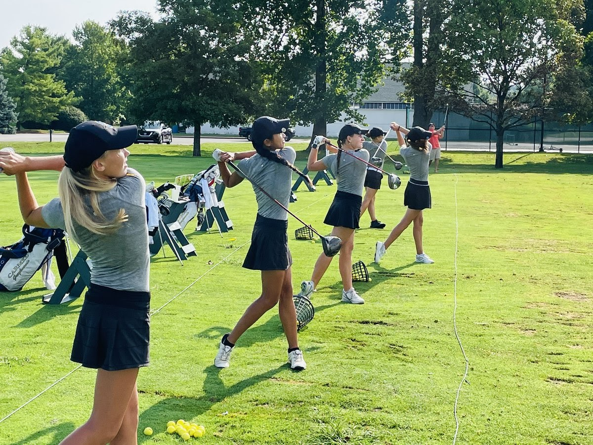 Members of the women's golf team practice before the MIC championship on August 31. According to head coach Kelly Kluesner, four members of the team earned all-conference honors at this meet. Picture from @CarmelGolfGirls on Twitter
